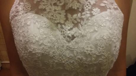 Nepoužité svatební šaty, 34