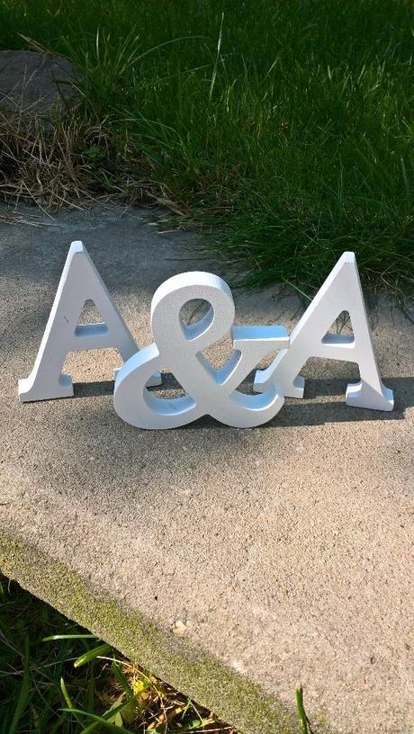 písmena A&A,