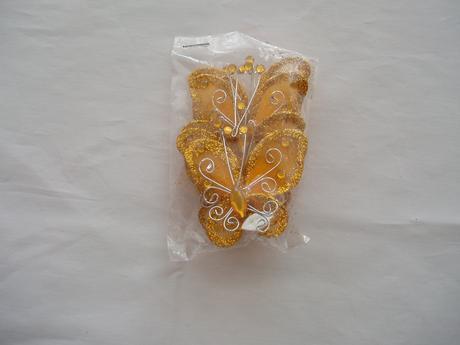 dekorační motýl s kamínkem,