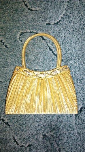 Zlatá kabelka, S