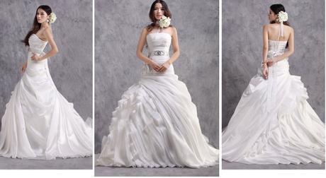 Svatební šaty s bohatou sukní, 38
