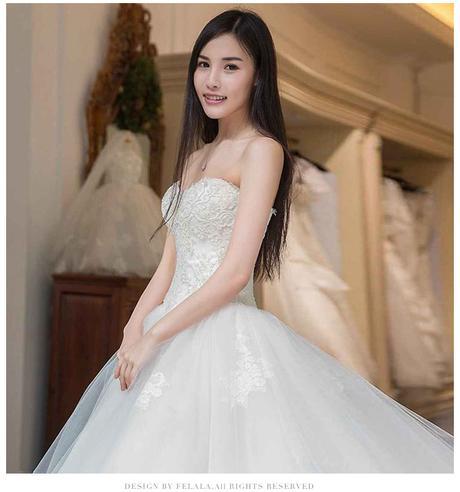 Svatební šaty s dlouhou vlečkou, 36