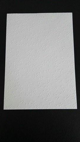 Bílý embosovaný papír zn. Heyda,