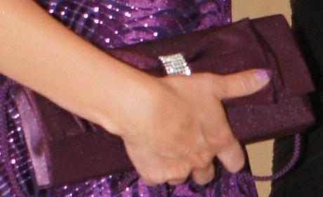kabelku fialovej farby, S