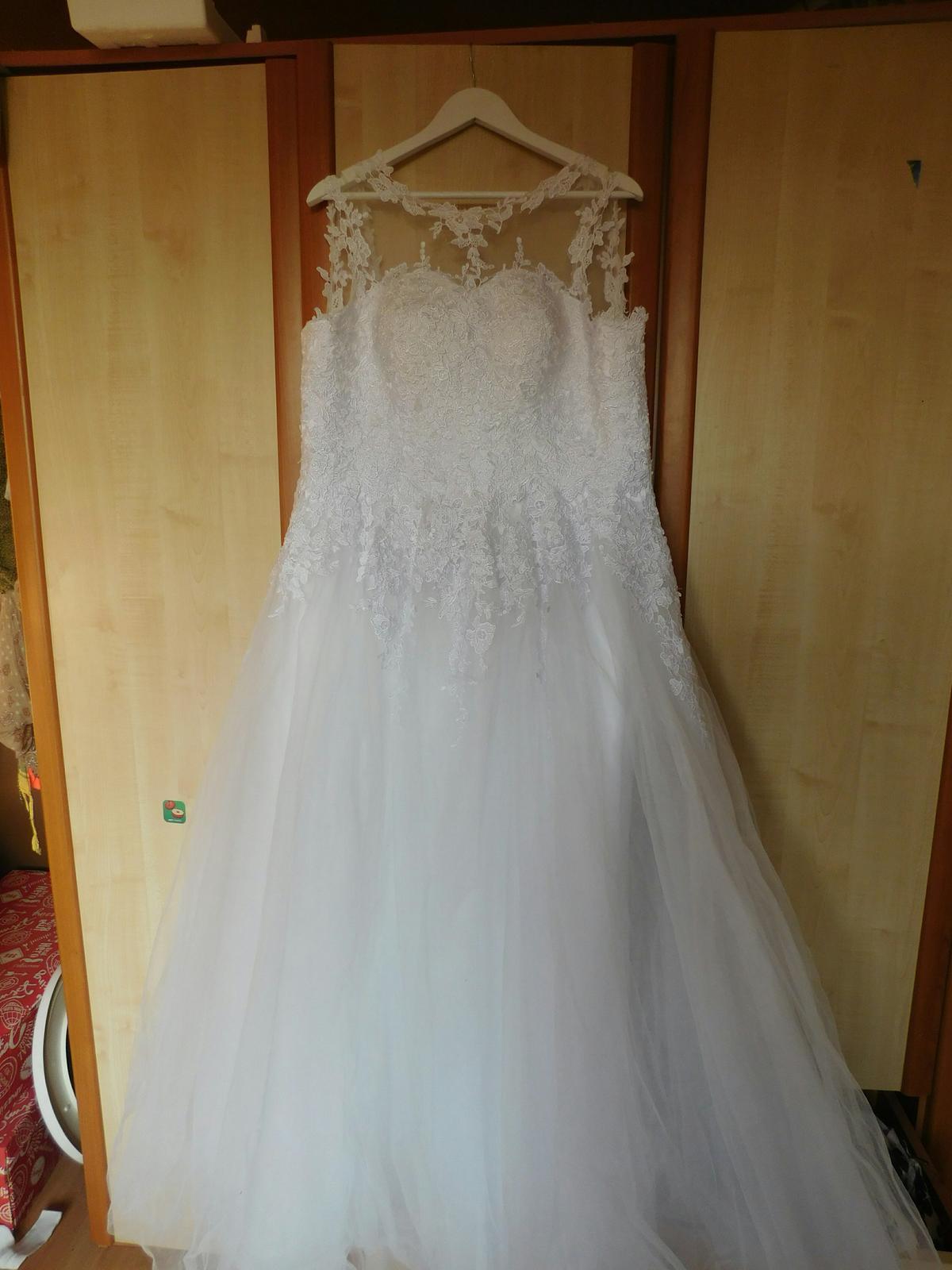 4017109b2fa1 Svatební šaty 42 - 46