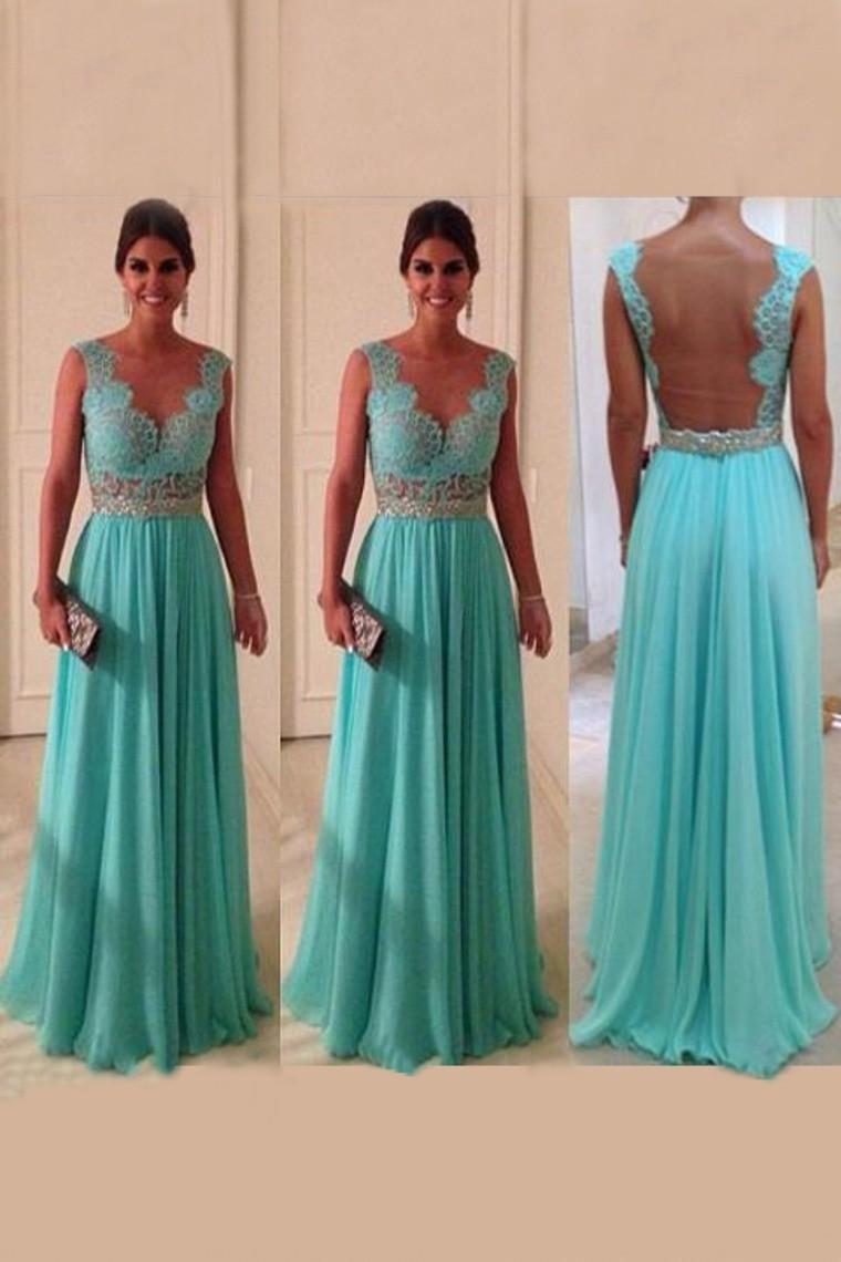 b35c2d895aec Tyrkysové modré plesové společenské šaty m