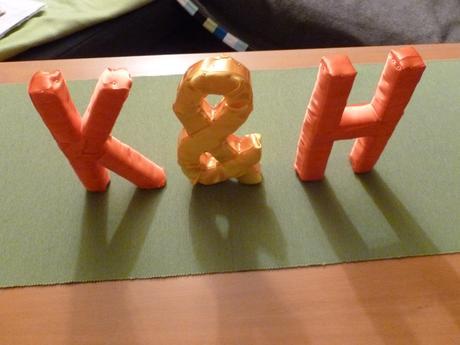Písmena K&H,