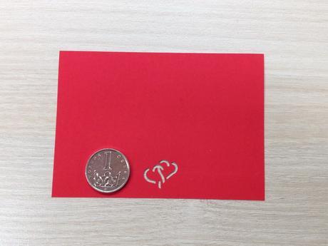 Ozdobná děrovačka 15 mm - propletená srdce,