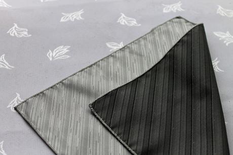 Nepoužitý černo-šedo-stříbrný kapesníček do klopy,