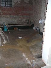 Prádelna - nové odpady, už zasypané a nachystané na betonování