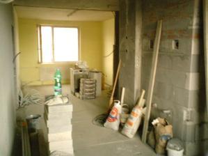 po zbúraní steny sa nám priestor krásne otvoril a bude kuchyňa prepojená s obývačkou-pohľad z kuchyne