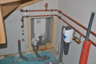 Odvod kondenzátu z komína a příprava připojení sifonu pro vypouštěcí ventil chladící smyčky teplovodní krbové vložky