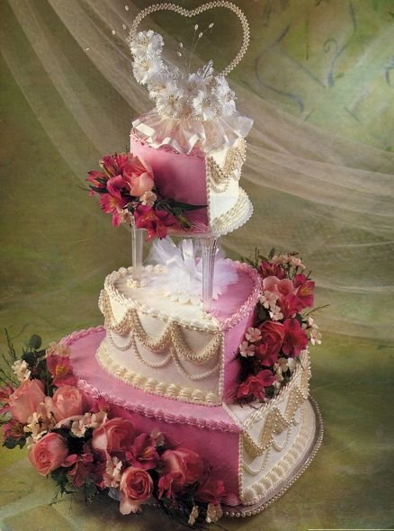 Náš objednaný svatební dort - barva bude oranžová a místo živých květů marcipánové