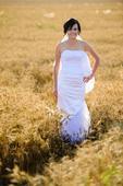 Biele svadobné šaty s vlečkou , 38