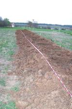 uložení stávajícího kabelu Telefonica O2 do betonových chrániček...