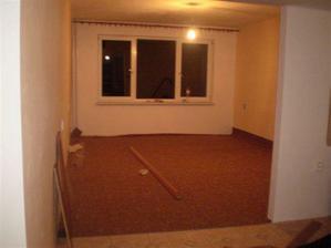 nový koberec v obýváku