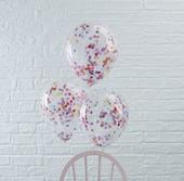 Priehľadný balón so farebnými konfetami,