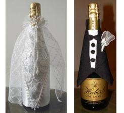 nádherne vyzdobené fľaše sektu pre novomanželov