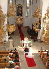 V kostele pri obradu