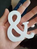 Pismeno J, T a symbol &,