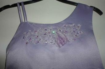 Detail on dress, thinking of taking the flower of and replacing it with a cadburys purple flower