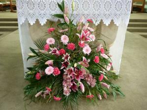 Lovely display of flowers at church this weekend - going to have something similar with roses, orchids, lillies, gerberas and lisianthums in red and white xx