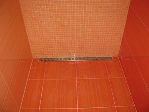 žlab v sprchovom kute