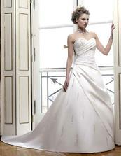 Šaty od pařížského návrháře Bellamiho ze salonu Exclusive v Brně.