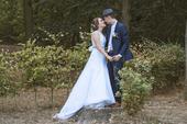 Svatební šaty na menší postavu s vlečkou, 34