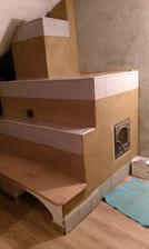obklad konečne hotovo :-) ešte vyšpárovať, namaľovať pec, omietnuť zadnú stenu a namaľovať lavicu :-)