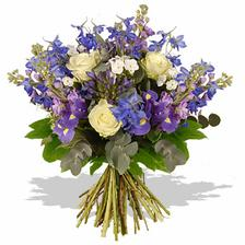 white roses with the blue delphinium and purple iris is complemented by the hazy blue-green foliage of the eucalyptus