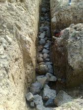 Nahadzanie kamenov na spodok zakladov