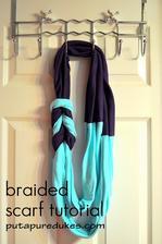 DIY: http://www.putapuredukes.com/2011/09/braided-scarf-tutorial.html