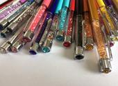 Swarovski pero-JONQUIL v darček. krabici s poštou ,