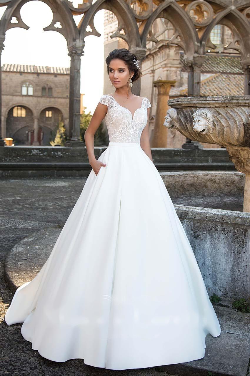 Sníte o sněhově bílých svatebních šatech? - Obrázek č. 2