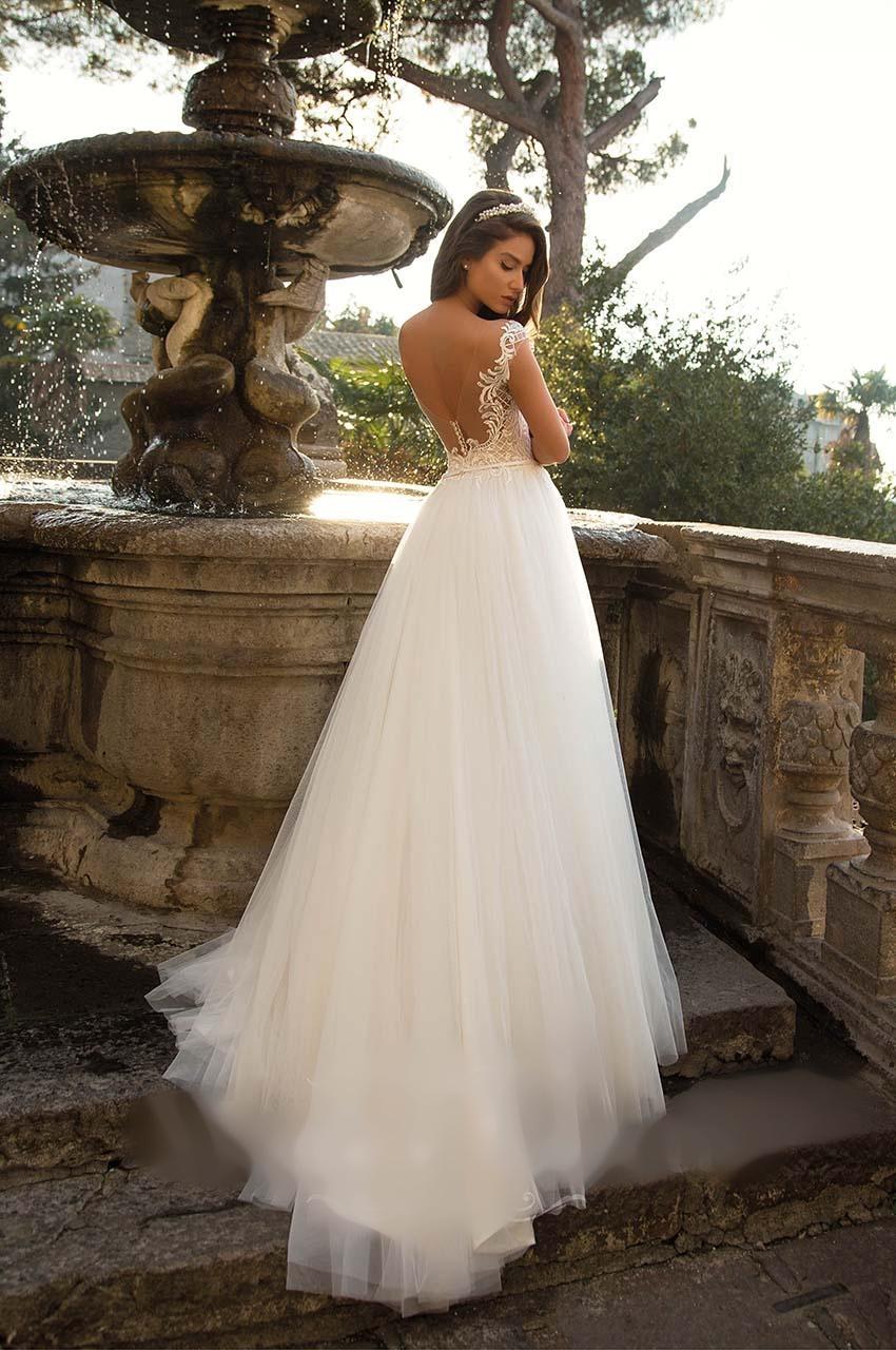 Sníte o sněhově bílých svatebních šatech? - Obrázek č. 9