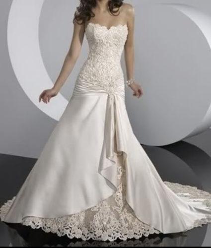 Dievčatá chcem sa vás opýtať že či náhodou neviete v akom svadobnom salóne majú tieto svadobné šaty... Ďakujem za informácie :) - Obrázok č. 1