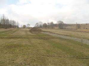 Nas stavebny pozemok s pristupovou cestou.