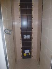 WC - obklad a dlažba sú už vyšpárované, treba už len osadiť WC a tlačidlo na splachovanie.