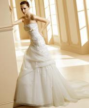 moje svadobné šaty...ale ... na mne to tak nevyzerali dobre