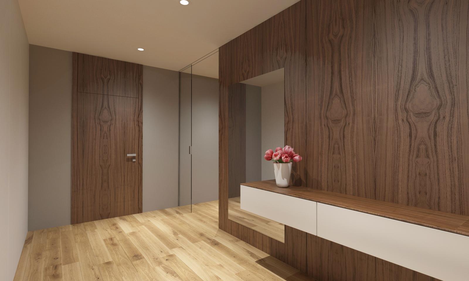 Návrh interiéru bytu - Interiér bytu v orechovom prevedení - vstupná chodba s dýhovaným orechovým obkladom a interiérovými dverami so zvýšenou zárubňou