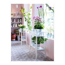 tento stojan na kvety do relaxacneho kuta ku kreslu v obyvke a pllllno kvetov :-)