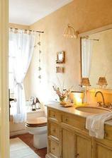 Veľká kúpelňa v marhuľovom odtieni v kombinácii s drevom - drev.komoda pod umývadlom, mram. doska, drevená garniža nad vaňou aj sedátko na WC, drevená podlaha, mosadzné batérie a doplnky