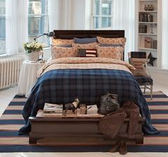 Na konci postele lavica