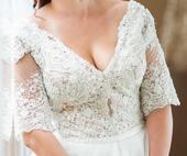 Šaty s krásnou korálkovou výšivkou od R.Bartolena, 40