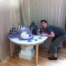 Hubby with our actual cakes the night before we got married