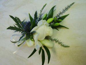 Corsage. Rose and Thistle Corsage with White Heather and Freesia.