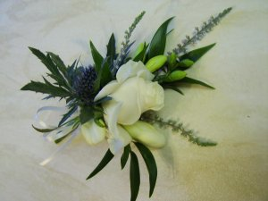 Flowers Prep - Corsage. Rose and Thistle Corsage with White Heather and Freesia.