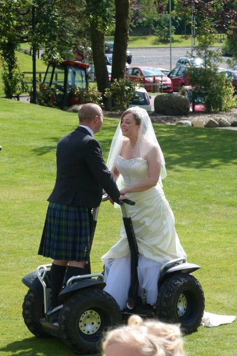 Kathryn beard{{_AND_}}Iain larkin - segway-hard to do in a wedding dress!!