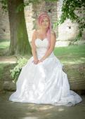 Saténové svatební šaty s překládaným korzetem, 38